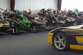 Sports car and snowmobiles